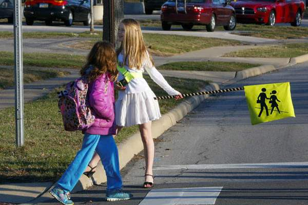 Crossing-guard-Lizzy-Lucal-right-helps-the-lead-student-fro