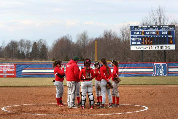 Softball09p-Central-Catholic-brings-it-in-to-regroup-d