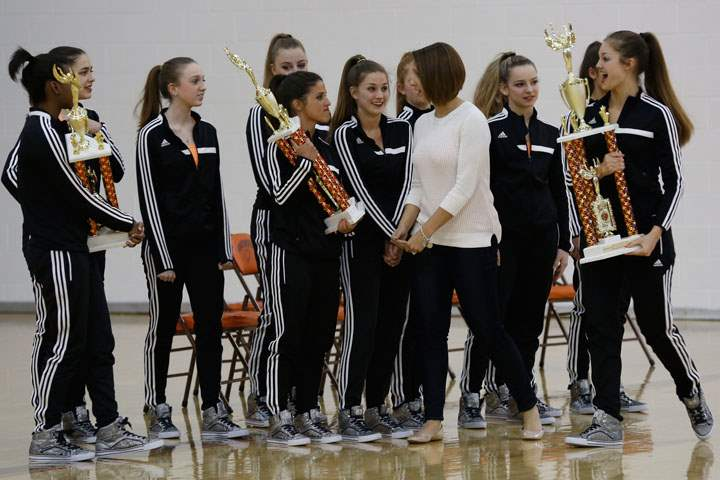 Southview-dance-team-coach-Adrienne-Salon-walks-past-her-state-championship-team
