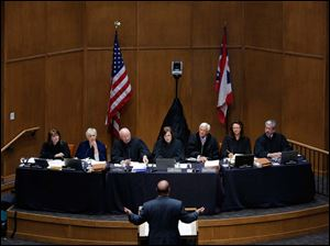 From left: Justice Judith L. French, Justice Judith Ann Lanzinger, Justice Paul E. Pfeifer, Chief Justice Maureen O'Connor, Justice Terrence O'Donnell, Justice Sharon L. Kennedy, and Justice William M. O'Neill listen to Douglas Cole, an attorney for Cedar Fair LP.