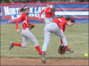 Central Catholic's junior Maggie Buchele, right, can't quite get ahold of the grounder hit by a Springfield batter during the bottom of the third inning.