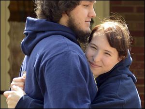 Franklin Regional High School Junior Gracye Evans hugs boyfriend Jacob Fritch at her home after school. She applied pressure to a fellow student's stab wound until he could be treated.