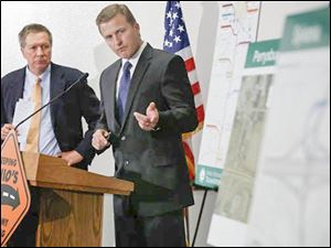 Ohio Governor John R. Kasich, left, and ODOT District 2 deputy director Todd Audet speaks.