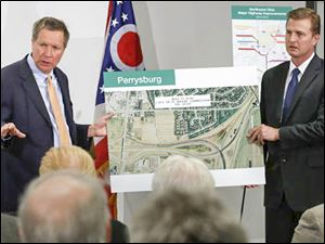 Ohio Governor John R. Kasich, left, and ODOT District 2 deputy director Todd Audet.