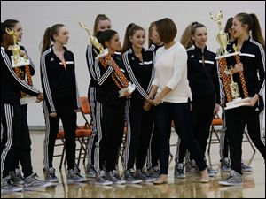 Southview dance team coach Adrienne Salon walks past her state championship team.