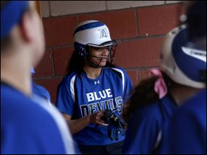 Springfield's catcher Kierra Hague, center, smiles after retuning to the dugout fresh off her first of two home runs.