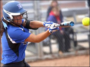 Springfield's junior Hannah Girlie gets off a hit during the bottom of the third inning.