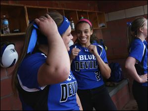 Springfield's sophomore Lexi Buck, left, and sophomore Kierra Hague, center, cheer after Buck added her home run to Hague's two in the bottom of the fourth inning.