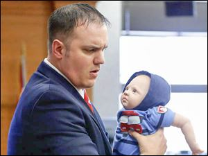 Prosecutor Frank Spryszak demonstrates how 6-month-old Avery Bacon may have been allegedly murdered.