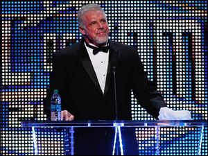The Ultimate Warrior speaks during the WWE Hall of Fame Induction at the Smoothie King Center in New Orleans on Saturday