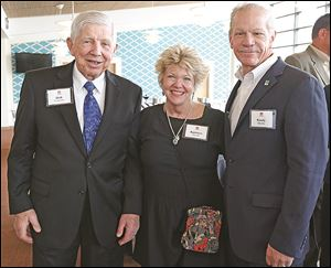 From left, Dick Anderson, left, Kathleen Carroll, and Randy Oostra.