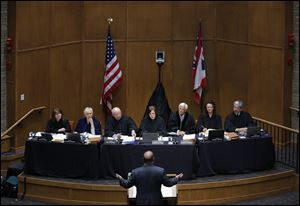 From left: Justice Judith L. French, Justice Judith Ann Lanzinger, Justice Paul E. Pfeifer, Chief Justice Maureen O'Connor, Justice Terrence O'Donnell, Justice Sharon L. Kennedy, and Justice William M. O'Neill listen as Douglas Cole, an attorney for Cedar Fair LP, argues during a session of the Supreme Court of Ohio in the McQuade Law Auditorium at The University of Toledo College of Law Wednesday, April 9, 2014.  The event is part of the courtÕs Off-Site Court Program.