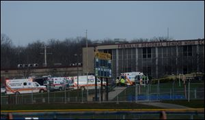 Emergency responders gather at the high school on the campus of the Franklin Regional School District, where several people were stabbed early today.