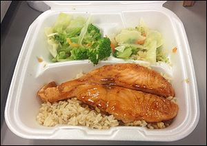 Salmon teriyaki with brown rice and mixed vegetables.