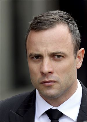 Oscar Pistorius arrives at the high court in Pretoria, South Africa, today.