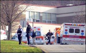 Officials outside of Franklin Regional High School in Murrysville, where multiple people were stabbed early today.