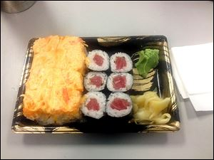 The spicy girl, filled with tempura salmon and topped with spicy crab, is paired with a basic tuna roll.