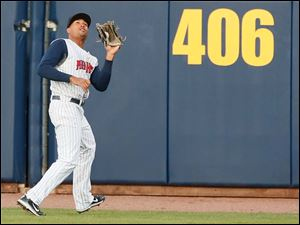 Toledo Mud Hens center fielder Daniel Fields makes a play against Indianapolis.