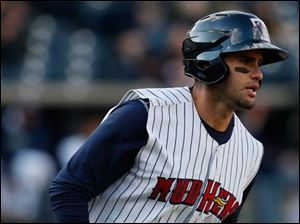 Toledo Mud Hens designated hitter J.D. Martinez heads to first base.