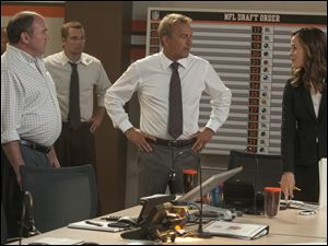 "Kevin Costner and Jennifer Garner in a scene from ""Draft Day."""