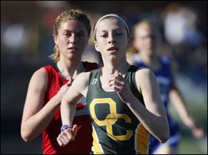Clay's Haley Hess wins the 1600 meter run.