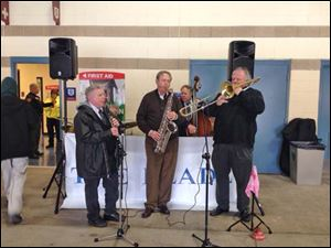 Toledo Jazz Orchestra quartet played at 5/3 Field on opening day as fans poured in for the game. Gene Parker on clarinet John Fedderke on saxiphone, Jeff Halsey on bass and Ron Kischuk on Trombone.