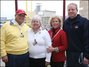 Steve and Peggy Klepper, left, attended the Toledo Mud Hens' opening day game with Janie and Tom Manahan, right, at the Lathrop's Opening Day Party from the roost at Fifth Third Field.