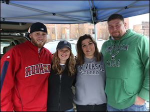 Corey Wholf, left, Christy Cromly, center left, Wendy Ladd, center right, and Brad Huntley, all of South Toledo, right, tailgated before the beginning of the game.