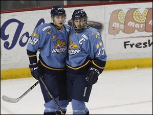 Maxim Shalunov is congratulated by Walleye captain Kyle Rogers after his gaol in the second period.