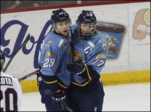 Maxim Shalunov is congratulated by Walleye captain Kyle Rogers after his goal in the second period.
