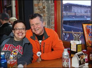 Christine Knack, of West Toledo, left, and Dale Thompson, of Petersburg, right, grabbed window seats at Fricker's.