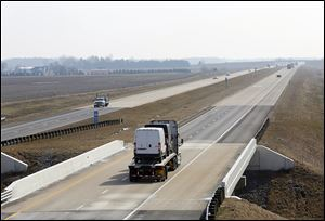 The new U.S. 24, shown stretching east near Texas, Ohio, has cut down on truck traffic in small communities along the old route.