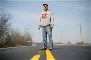 Matt Coger, in the middle of old U.S. 24 near Texas, Ohio, says the old route is now like a 'country road.'