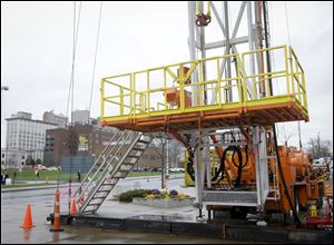 A large drilling rig sits outside the Covelli Center with some of the Youngstown, Ohio skyline in the background in November, 2011 for the Youngstown Ohio Utica & Natural Gas Conference & Expo.
