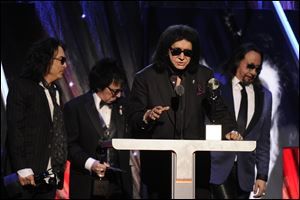 Hall of Fame Inductees, KISS, Paul Stanley, Peter Criss, Gene Simmons, and Ace Frehley speak at the 2014 Rock and Roll Hall of Fame Induction Ceremony.