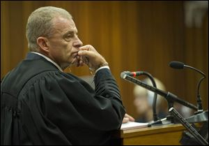 State prosecutor, Gerrie Nel, questions Oscar Pistorius in court in Pretoria, South Africa,  today.