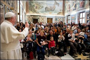 Pope Francis delivers his blessing during a meeting with the Italian pro-life movement, at the Vatican today.