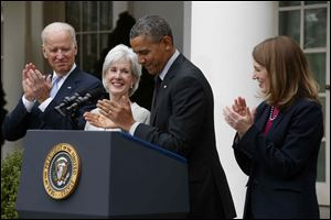 President Barack Obama and Vice President Joe Biden stand with outgoing Health and Human Services Secretary Kathleen Sebelius, second from left, and his nominee to be her replacement, Budget Director Sylvia Mathews Burwell, today in the Rose Garden of the White House in Washington.