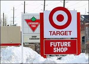 In March, 2013, signs for the new Target store in Guelph, Ont., and the popular Canadian Tire appear to fight for attention for Canadian shoppers.