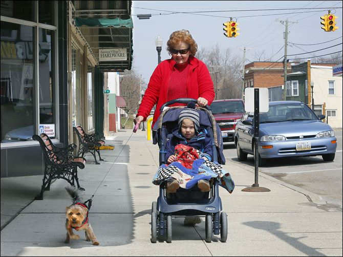 13n1stroll-2 Anita Friend takes a stroll with her grandson Benton Rogge, 2, and her dog Lucy in downtown Antwerp.