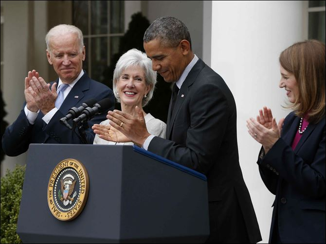 Obama Health Secretary Resignation Sebelius Burwell President Barack Obama and Vice President Joe Biden stand with outgoing Health and Human Services Secretary Kathleen Sebelius, second from left, and his nominee to be her replacement, Budget Director Sylvia Mathews Burwell, today in the Rose Garden of the White House in Washington.