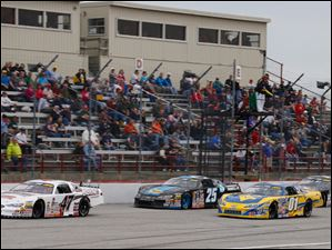 Brian Campbell (47) leads Derrick Griffin (25) Travis Braden (01) and Ross Kenseth (77) during the 7Up 150 at Toledo Speedway. Campbell won the race.