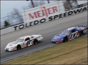 Brian Campbell (47) leads Ross Kenseth (77) during the 7Up 150 at Toledo Speedway.
