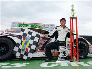 Brian Campbell poses with his trophies after winning the 7Up 150 at Toledo Speedway.
