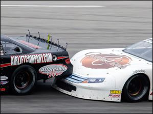 The car driven by Anderson Bowen (29) gets into the back of Chad Finley (42) during the race