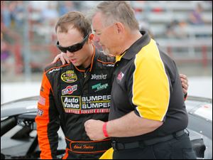 Driver Chad Finley, Dewitt, MI., prays quickly with chaplain Larry Avery, Anderson, Ind., before climbing in his car for the race.