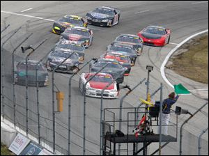 Drivers in the last chance race for the 7Up 150 get the green flag at Toledo Speedway,