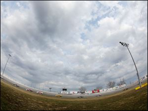 A fisheye lens adds drama to the already dramatic turns three and four during the 7Up 150 at Toledo Speedway.
