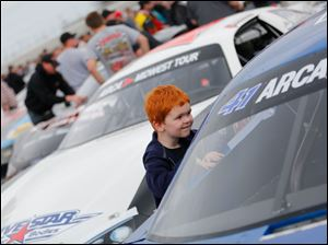 Keith Shulters, 4, Swanton, gets an up close look at a race car before race.