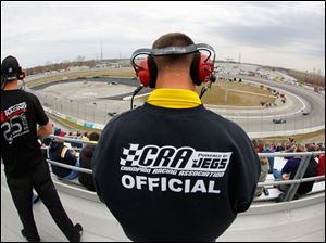 A CRA official watches over the last chance race for the 7Up 150 at Toledo Speedway.